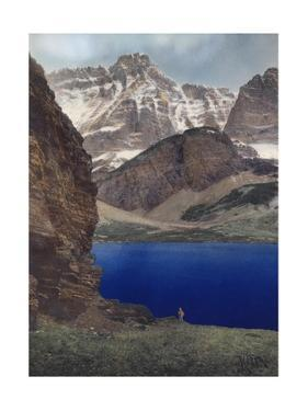 The Rocky Mountains' Peaks and Ridges Engulf the Sapphire Colored Lake by A. H. Barnes