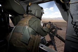A Hh-60G Pave Hawk Gunner Fires His Gau-17 Machine Gun