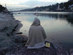 A Hindu Pilgrim Meditates Along the Bank of the Ganges River