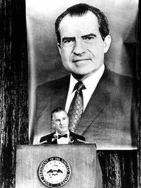 A Huge Portrait of President Nixon Dominates the Scene