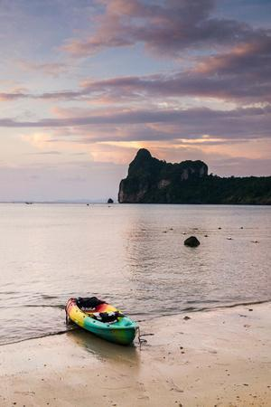 https://imgc.allpostersimages.com/img/posters/a-kayak-on-the-shore-of-phi-phi-island-at-sunset_u-L-Q1BBCQ00.jpg?p=0