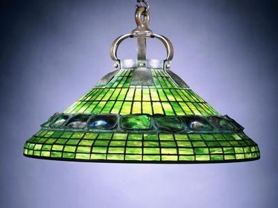 https://imgc.allpostersimages.com/img/posters/a-leaded-glass-turtleback-tile-and-bronze-chandelier_u-L-PPVKHH0.jpg?p=0