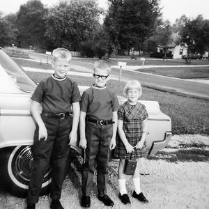 A Lineup of Kids by the Family Car. 1965