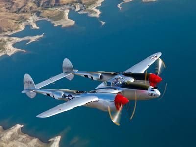 https://imgc.allpostersimages.com/img/posters/a-lockheed-p-38-lightning-fighter-aircraft-in-flight_u-L-PES2XJ0.jpg?p=0