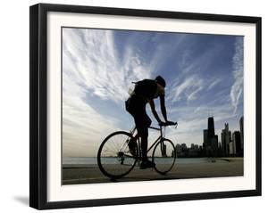 A Lone Cyclists Pedals Along Lake Michigan