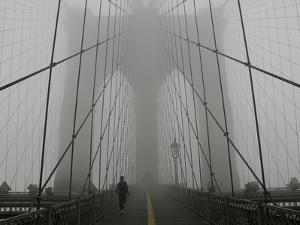 A Lone Runner Makes His Way Across the Fog-Shrouded Brooklyn Bridge Christmas Morning