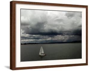 A Lone Sailboat Makes its Way Along Folsom Lake as Heavy Storm Clouds Approach