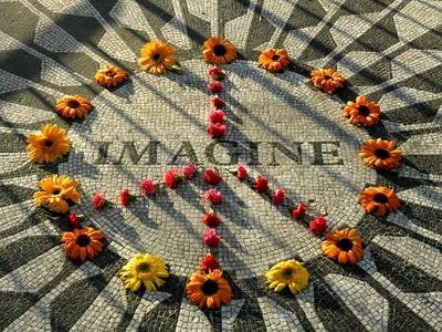 https://imgc.allpostersimages.com/img/posters/a-makeshift-peace-sign-of-flowers-lies-on-top-john-lennon-s-strawberry-fields-memorial_u-L-Q10OM390.jpg?p=0