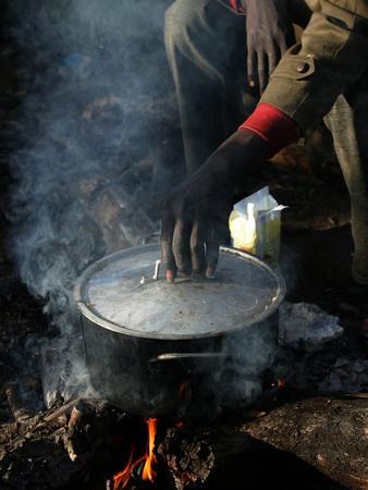 https://imgc.allpostersimages.com/img/posters/a-man-24-from-ghana-prepares-his-meal_u-L-Q10ORAW0.jpg?p=0