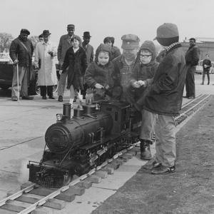 A Man Gives a Ride to Some Children on a Steam Locomotive Outside the Museum of Science and Industr