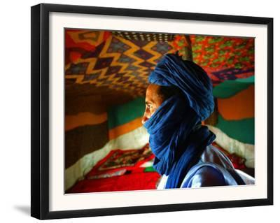 A Man, Wearing his Traditional Tuareg Turban, Stands in His Tent in Koygma