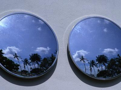 https://imgc.allpostersimages.com/img/posters/a-mirrored-view-of-palms-in-the-south-beach-art-deco-district-miami-florida-usa_u-L-P3SDM50.jpg?p=0