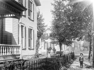 A neighbor, Daniel Henderson, in front of Wright home at 7 Hawthorn Street, Dayton, Ohio, 1897-1901