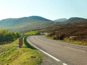 Country Road Winding through the Scottish Highlands. Uk. by A_nella