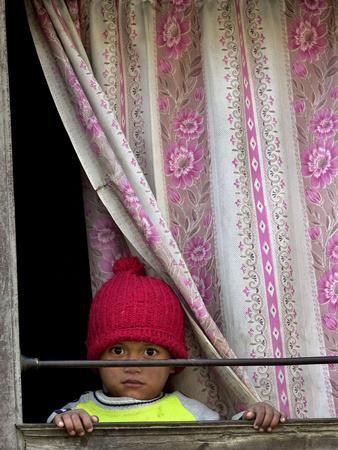 https://imgc.allpostersimages.com/img/posters/a-nepali-child-looks-out-from-a-window-at-pro-democracy-activists_u-L-Q10OPNE0.jpg?p=0