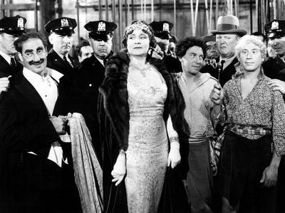 https://imgc.allpostersimages.com/img/posters/a-night-at-the-opera-groucho-marx-margaret-dumont-chico-marx-robert-o-connor-harpo-marx-1935_u-L-Q12P4HJ0.jpg?artPerspective=n