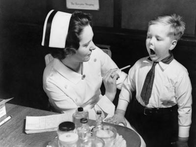 A Nurse Examining the Teeth of a Boy in New York, NY , Ca, 1935