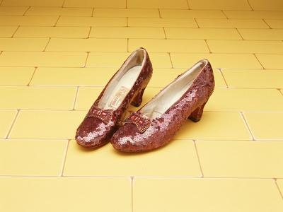 https://imgc.allpostersimages.com/img/posters/a-pair-of-ruby-slippers-worn-by-judy-garland-in-the-1939-mgm-film-the-wizard-of-oz_u-L-O5OYA0.jpg?artPerspective=n