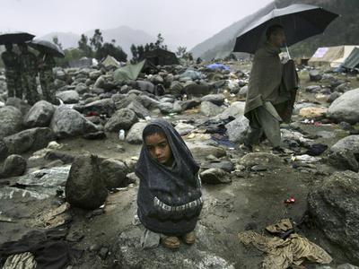 https://imgc.allpostersimages.com/img/posters/a-pakistani-earthquake-survivor-shivers_u-L-Q10ORE50.jpg?p=0