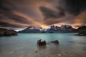 A Patagonia Scenic with the Andes Mountains, a Lake, and Dramatic Clouds