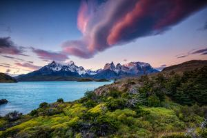 A Patagonia Scenic with the Andes Mountains, a Lake, Green Growth and Clouds