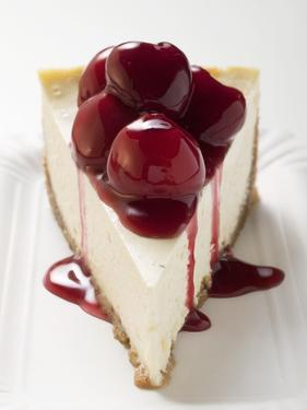 A Piece of Cheesecake with Cherry Sauce