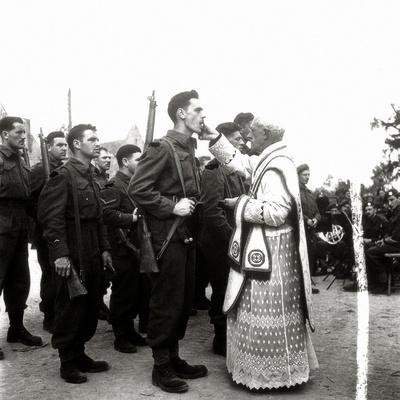 https://imgc.allpostersimages.com/img/posters/a-priest-gives-communion-to-soldiers-during-a-mass-rots-normandy-france-14th-july-1944_u-L-PQ389Y0.jpg?p=0