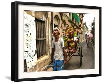 A Rickshaw Puller Carries Supporters of Brazil Soccer Team