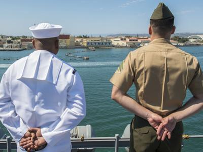 A Sailor and Marine Man the Rails Aboard USS Boxer