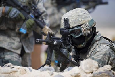 A Security Forces Airman Provides Cover for His Squad