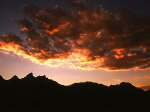 A Setting Sun Casts a Colorful Light on the Teton Mountains Near Jackson Hole