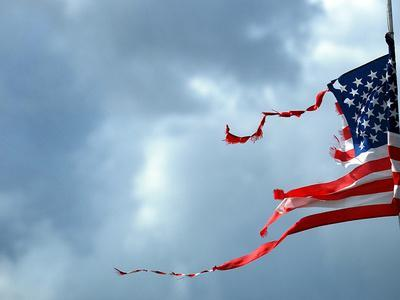 https://imgc.allpostersimages.com/img/posters/a-shredded-u-s-flag-is-blown-by-the-wind_u-L-Q10OQ260.jpg?p=0
