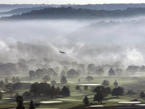 A Small Plane Descends Over Fog Covered Reeves Municipal Golf Course as It Lands at Lunken Airport