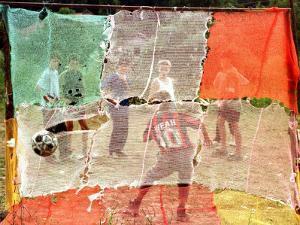 A Soccer Ball Slips Through an Opening of a Makeshift Goal During a Game Played by Bosnian Children