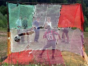 A Soccer Ball Slips Through an Opening of a Makeshift Goal