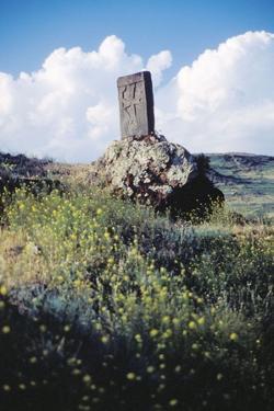 A Stone Cross (Khachkar) In Spring Near Lake Sevan In Armenia.