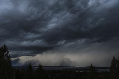 https://imgc.allpostersimages.com/img/posters/a-storm-brews-outside-of-yellowstone-national-park-wyoming_u-L-Q1BAQZU0.jpg?p=0