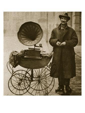 https://imgc.allpostersimages.com/img/posters/a-street-hawker-entertains-with-a-gramophone-transported-in-a-pram_u-L-P94IM90.jpg?p=0