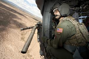 A Student Learns the Art of Aerial Gunnery in an Hh-60G Pave Hawk