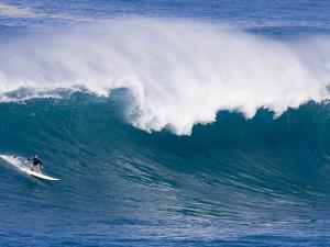 A Surfer Rides a Wave at Waimea Beach
