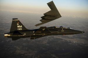 A T-38 Talon Flies in Formation with a B-2 Spirit