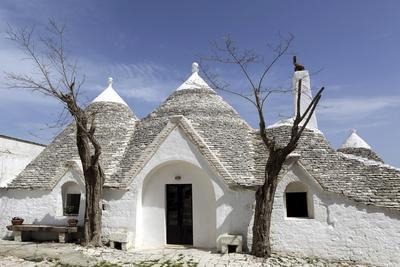 https://imgc.allpostersimages.com/img/posters/a-traditional-trullo-house-at-masseria-tagliente_u-L-PWFEKJ0.jpg?p=0