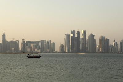 https://imgc.allpostersimages.com/img/posters/a-traditional-wooden-dhow-boat-sails-past-modern-skyscrapers-west-bay-financial-district-doha_u-L-PQ8QXN0.jpg?p=0