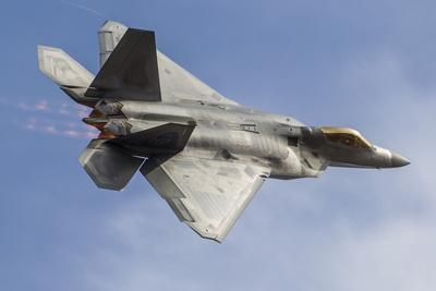 https://imgc.allpostersimages.com/img/posters/a-u-s-air-force-f-22-raptor-makes-a-fast-flyby_u-L-PU20280.jpg?p=0