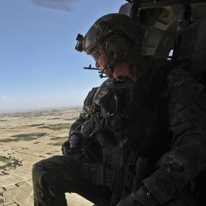 A U.S. Army Special Forces Soldier Looks Out from a Uh-60 Black Hawk