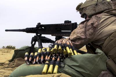 A U.S. Marine Fires an M2 .50 Caliber Machine Gun