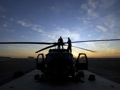 A UH-60 Black Hawk Helicopter on the Flight Line at Sunset