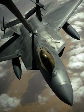 A US Air Force F-22 Raptor Is Refueled by a Kc-10A Extender Aircraft over Southwest Asia