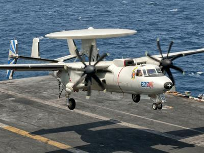 https://imgc.allpostersimages.com/img/posters/a-us-navy-e-2c-hawkeye-prepares-to-land-aboard-uss-eisenhower_u-L-PEREY70.jpg?p=0