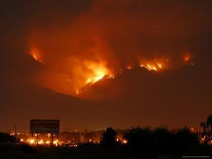 A Wildfire Can be Seen Raging in the Hills Over the Town of St. Ignatius, Montana